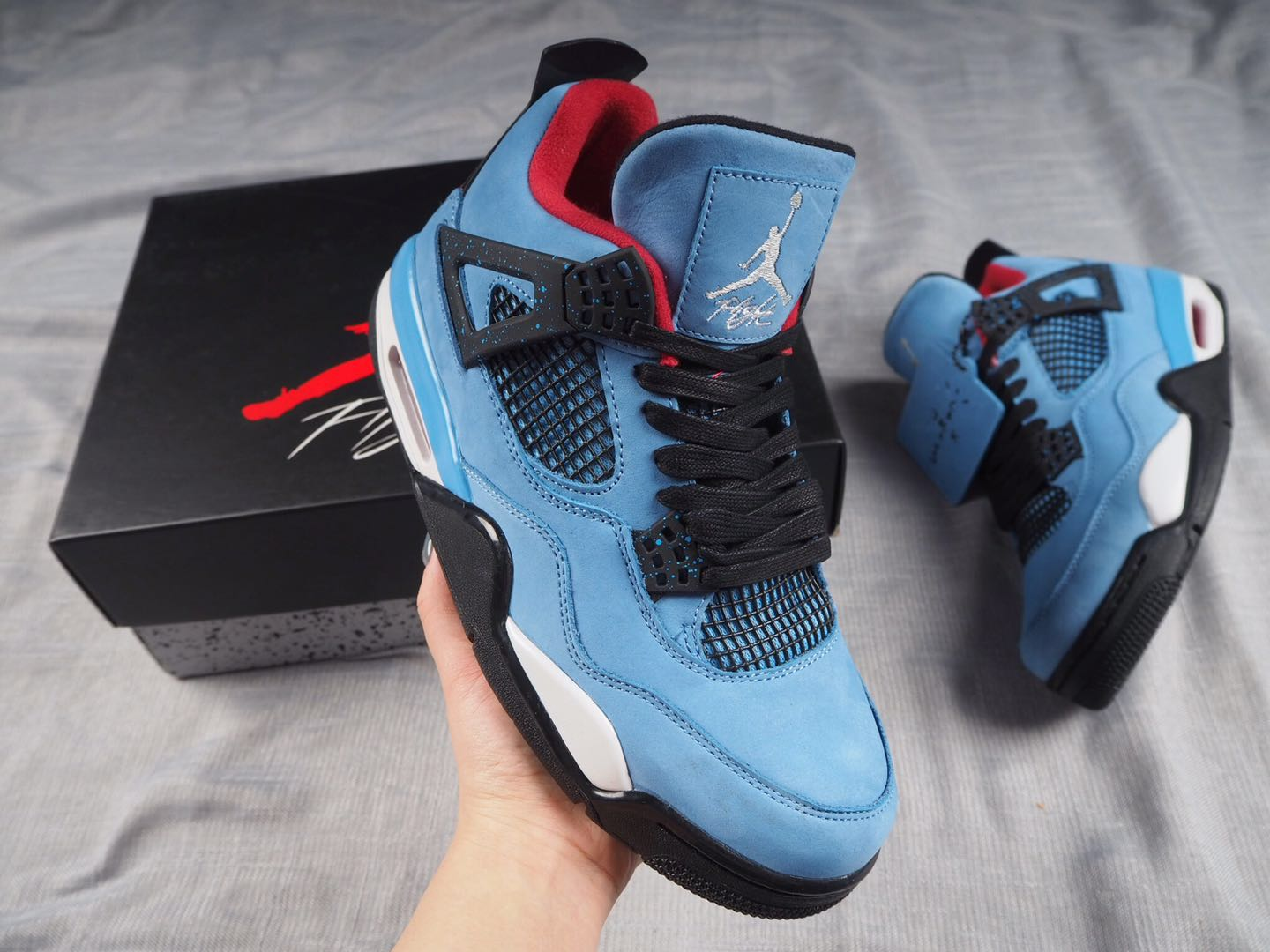 Travis Scott x Air Jordan 4 Houston Oilers University Blue